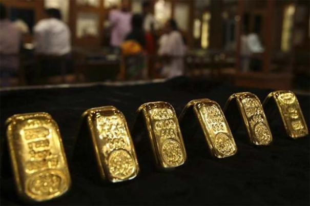Gold Futures Prices Trade Flat Onto Modest Gains Despite Dollar Strength